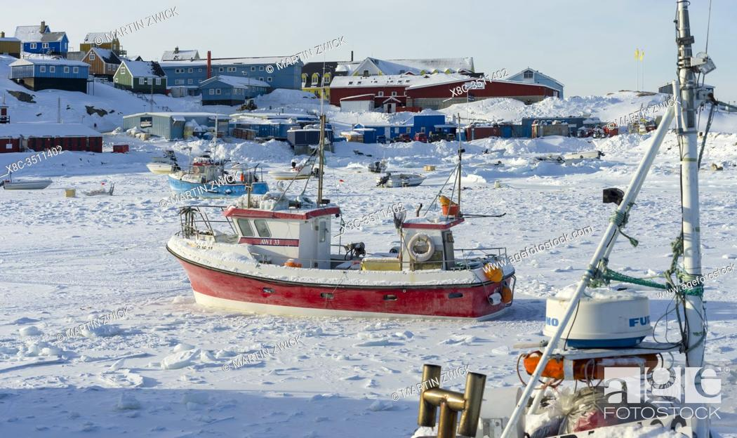 Stock Photo: Frozen harbour. Winter in the town of Upernavik in the north of Greenland at the shore of Baffin Bay. America , Denmark, Greenland.