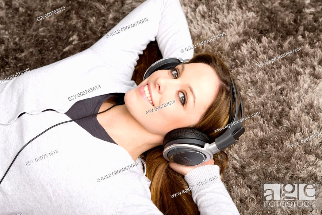 Stock Photo: Young woman listening music.