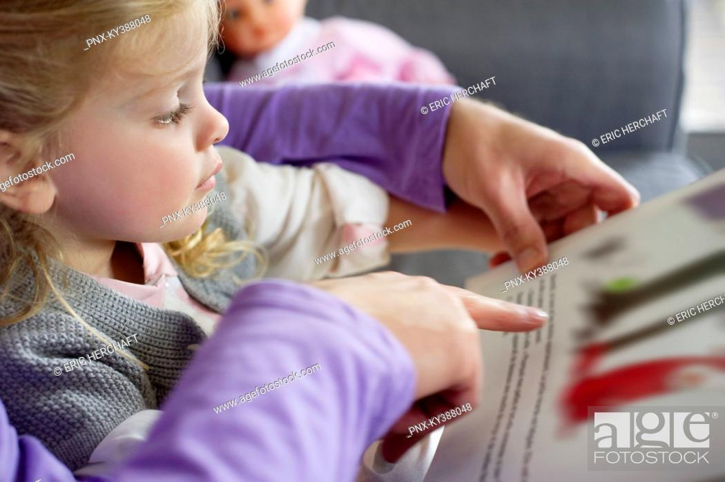 Stock Photo: Girl studying with her father at home.