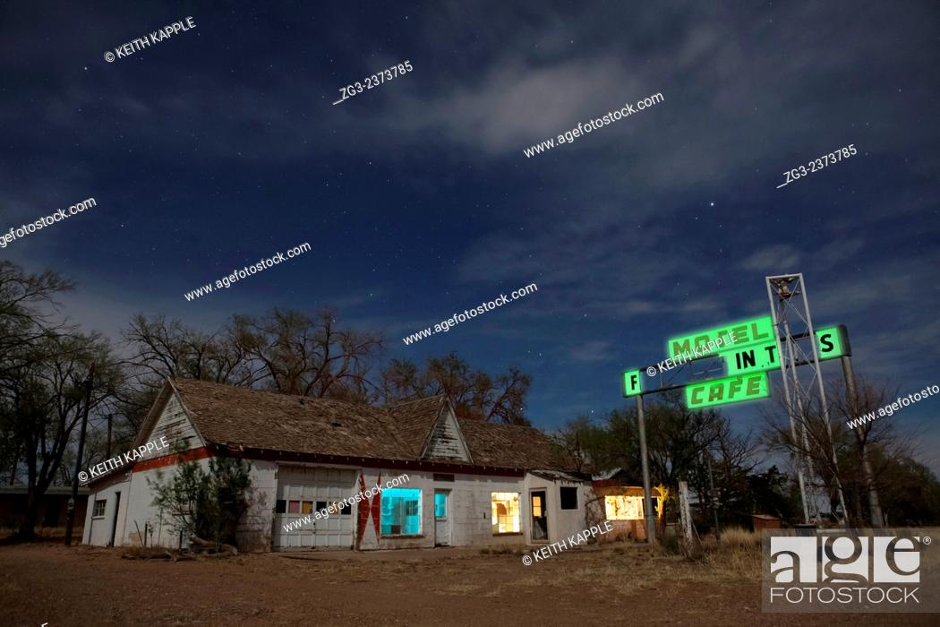 Stock Photo: Abandoned Old retro gas station at night, west Texas, USA.
