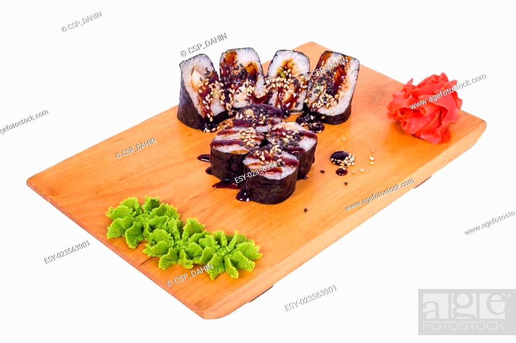 Imagen: composition of sushi on a wooden bo.