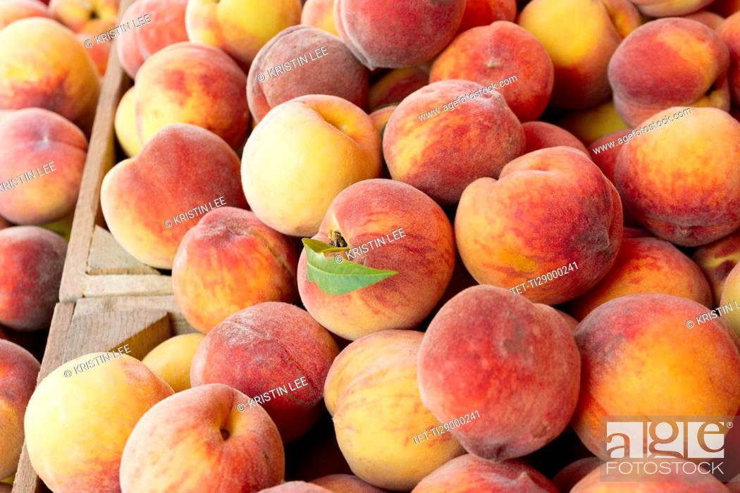 Stock Photo: Peaches in wooden crate.