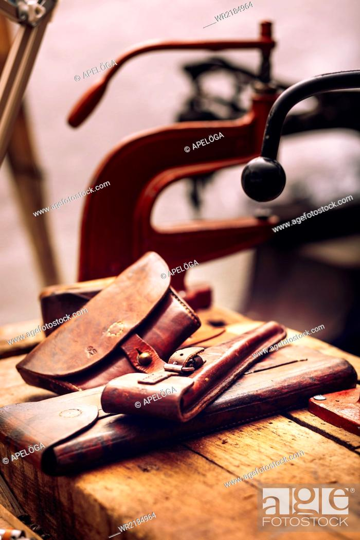 Stock Photo: Leather pouches on table at workshop.