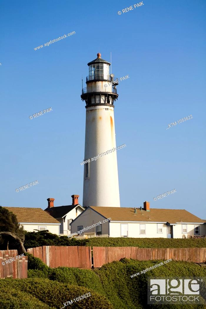 Stock Photo: At 115 feet Pigeon Point Lighthouse in California is one of the tallest lighthouses in America  From this view, the light station buildings at the base of the.