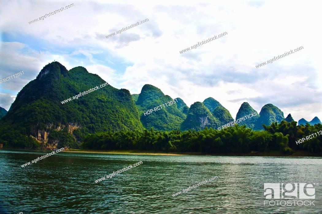Stock Photo: Trees at the riverside, Li River, XingPing, Yangshuo, Guangxi Province, China.