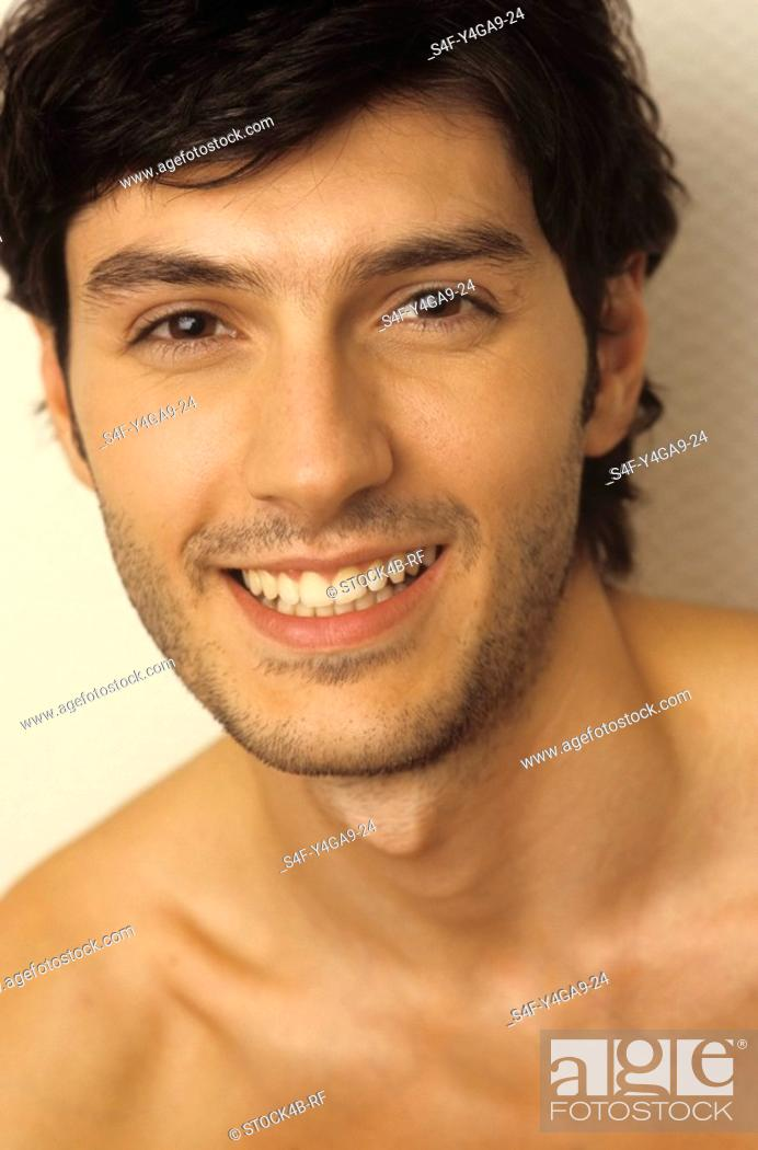 Stock Photo: Portrait of a Darkhaired Man - Happiness - Smile - Facial Expression.