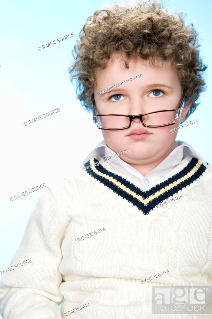 Stock Photo: Portrait of a boy wearing eyeglasses.