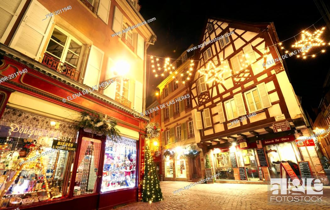Stock Photo: Typical timber-framing houses witn Christmas lights at the city center by night. Colmar. Wine route. Haut-Rhin. Alsace. France.