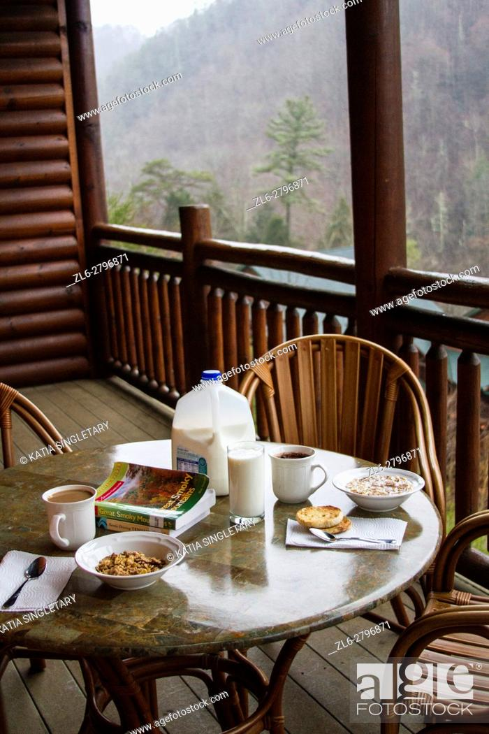 Stock Photo: Breakfast table set with milk and cereals on the wooded balcony of a ski resort. The view from the mountains is incredible.