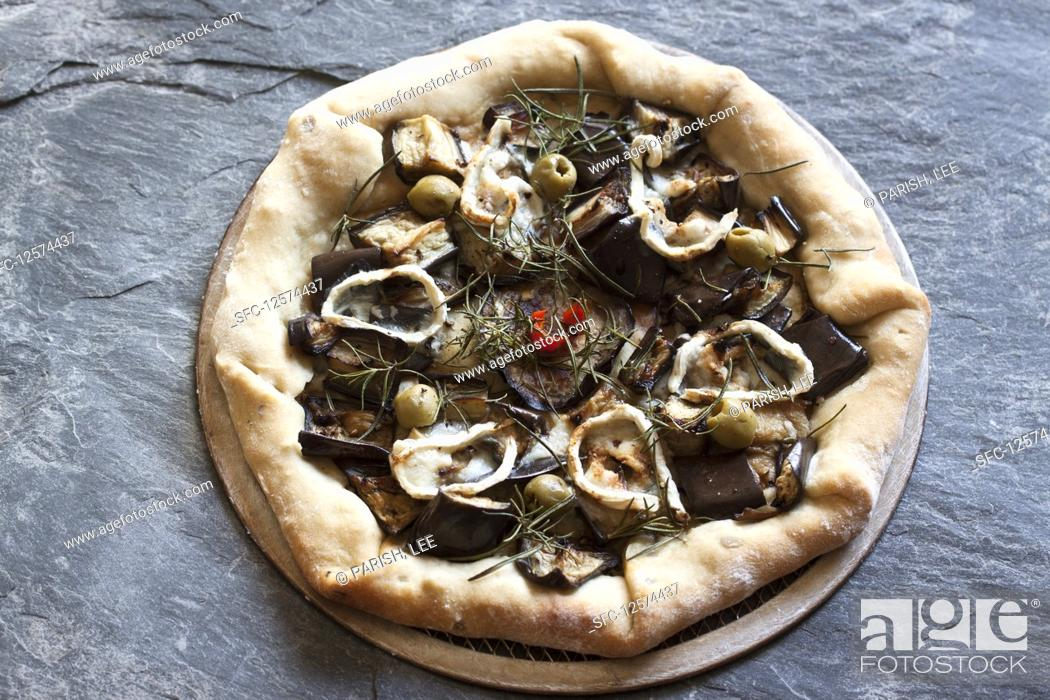 Stock Photo: Pizza topped with eggplant, goat's cheese, rosemary, red pepper and green olives.