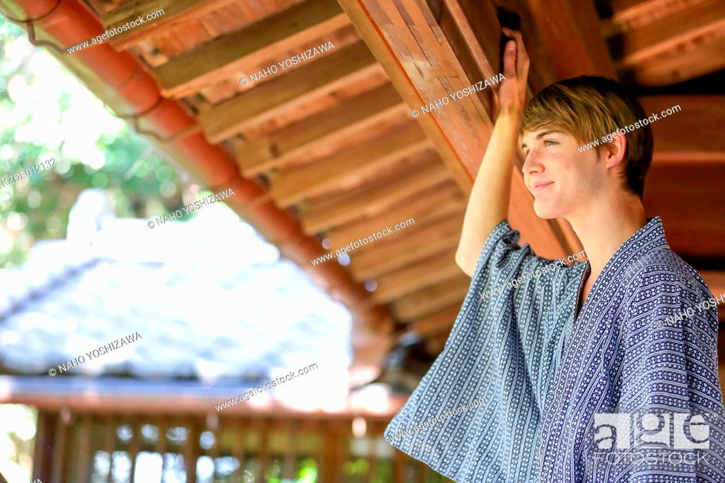 Stock Photo: Caucasian man wearing yukata in traditional Japanese house.