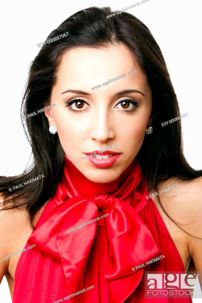 Stock Photo: Face of a beautiful happy Caucasian Hispanic woman with red satin bowtie shirt and red lipstick, isolated.