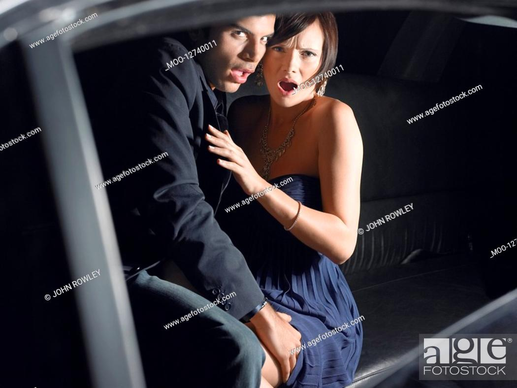 Stock Photo: Couple in back of limousine.