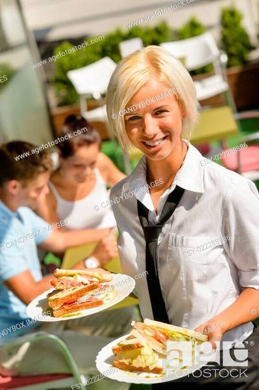 Stock Photo: Waitress bringing sandwiches on plates fresh lunch.