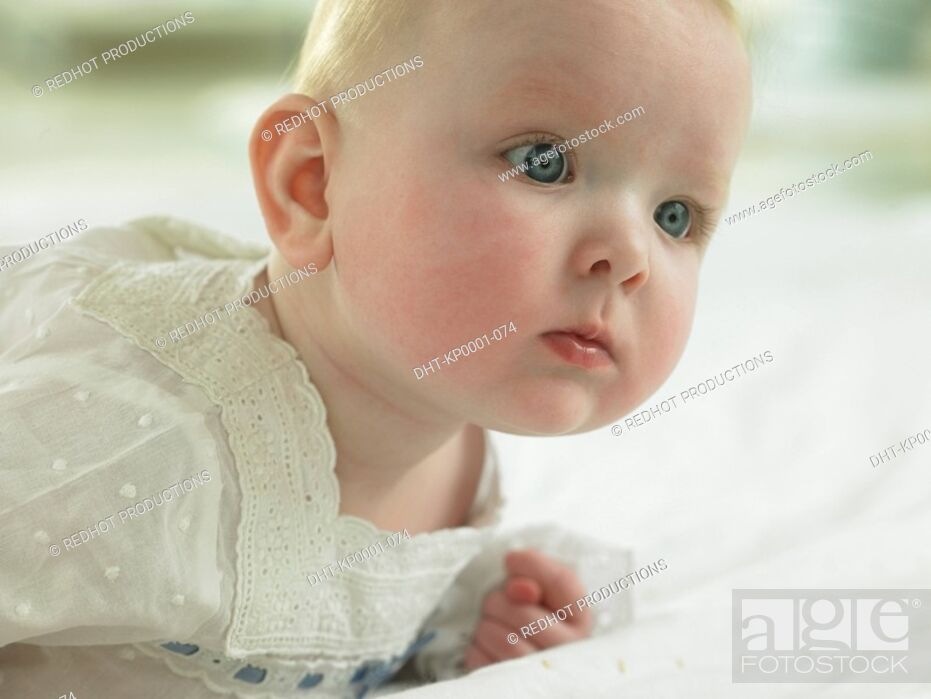 Stock Photo: Baby looking pensive.