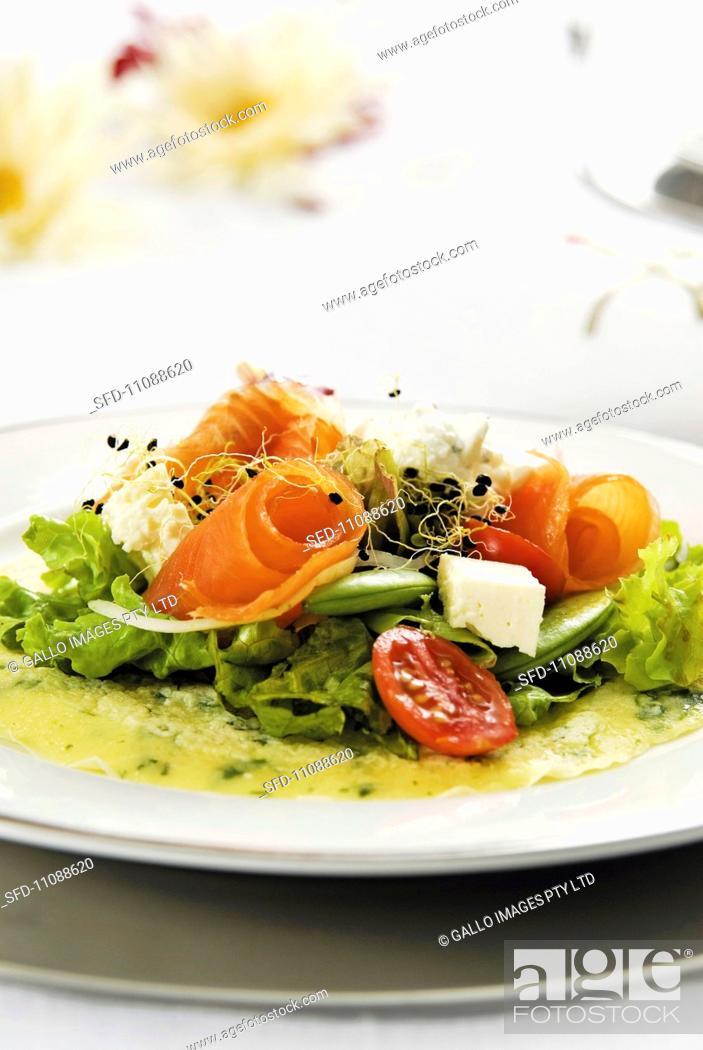 Stock Photo: Smoked salmon salad on herb pancakes.