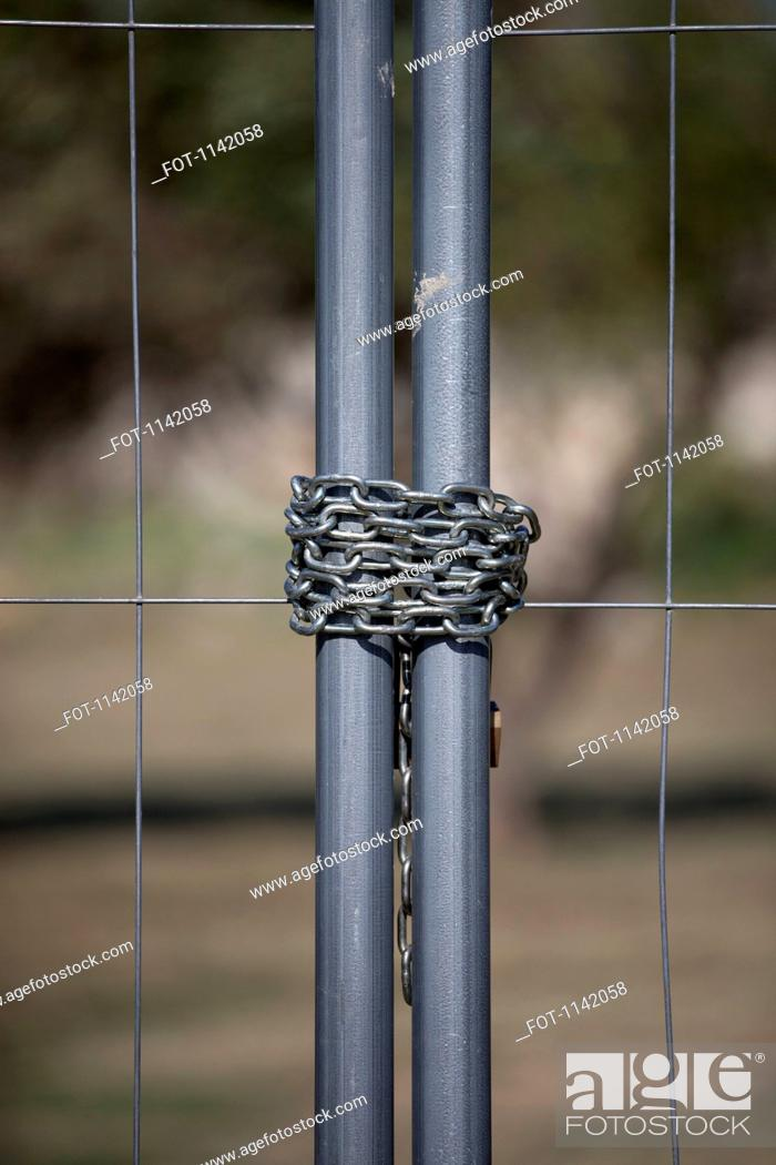 Stock Photo: Detail of a chain on a metal gate.