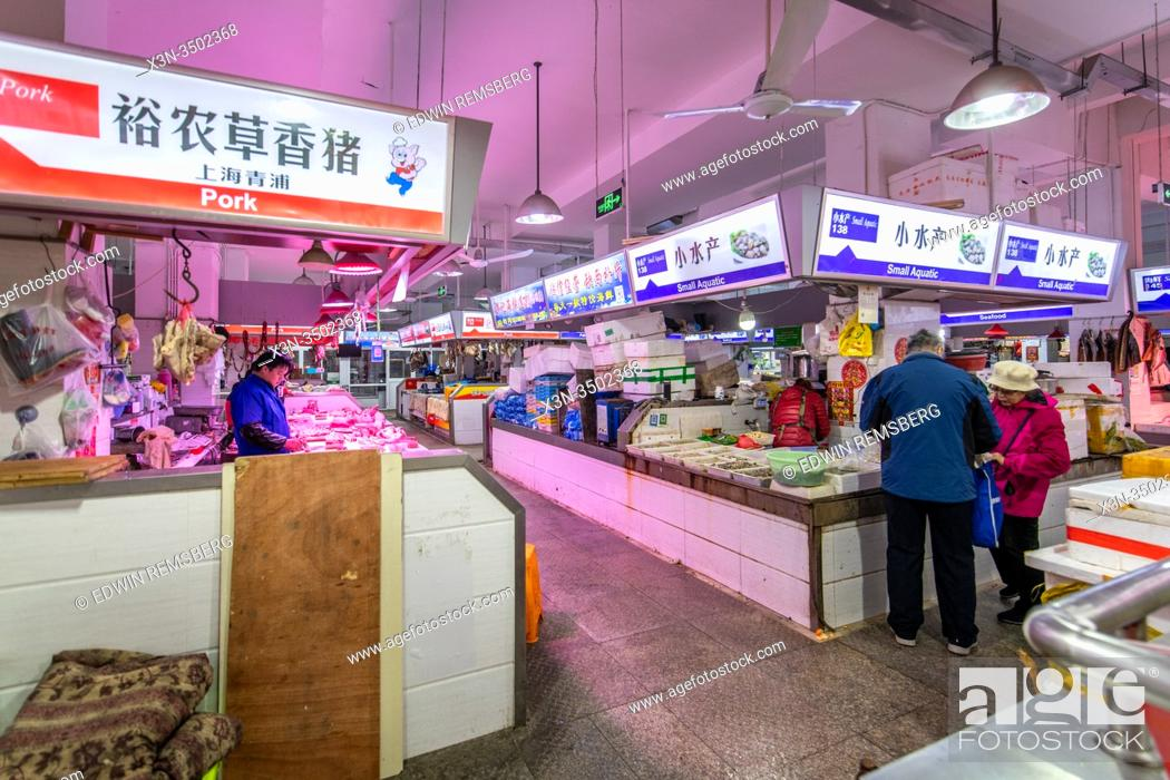 Stock Photo: Various meat and seafood stalls at a market in Shanghai, China.