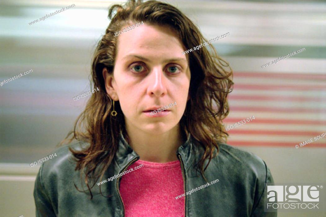 Stock Photo: Woman and blurred subway train.