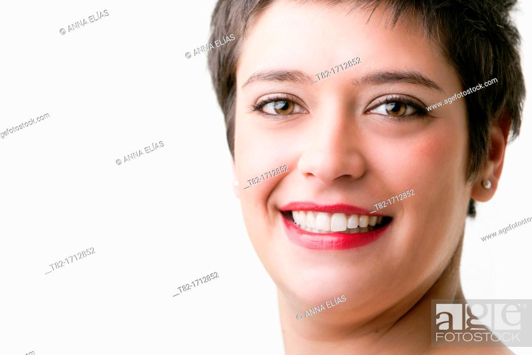 Stock Photo: closeup of young woman showing white teeth.