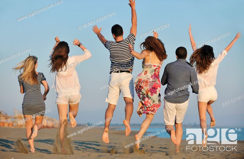 Stock Photo: happy young people group have fun on beach.