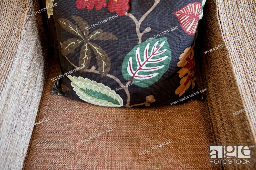 Imagen: Close-up of a throw pillow on armchair at home; California; USA.