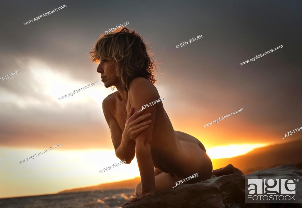 Stock Photo: Nude woman on the beach.