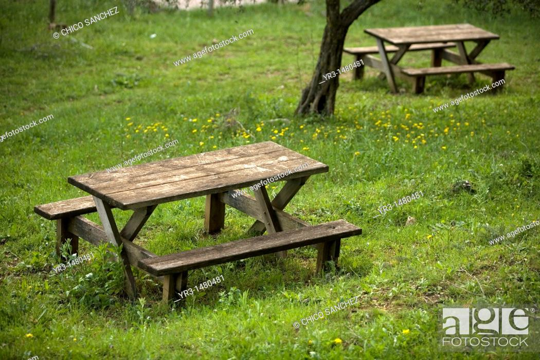 Stock Photo: Wooden benches in a green field of El Gastor village in the Sierra de Grazalema Natural Park, Cadiz province, Andalusia, Spain, april 25, 2011.