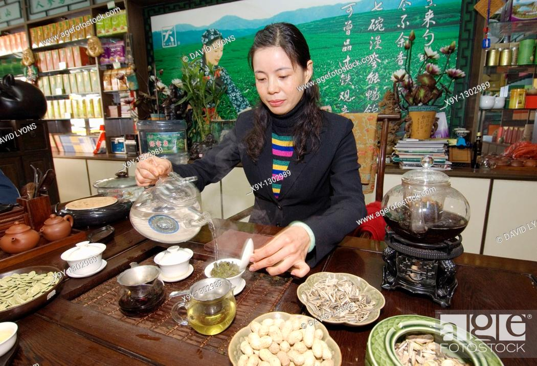 Stock Photo: Tea merchant Lin Guang Xia serving fine Chinese green tea in headquarters of her tea shop chain  Zibo, Shandong Province, China.