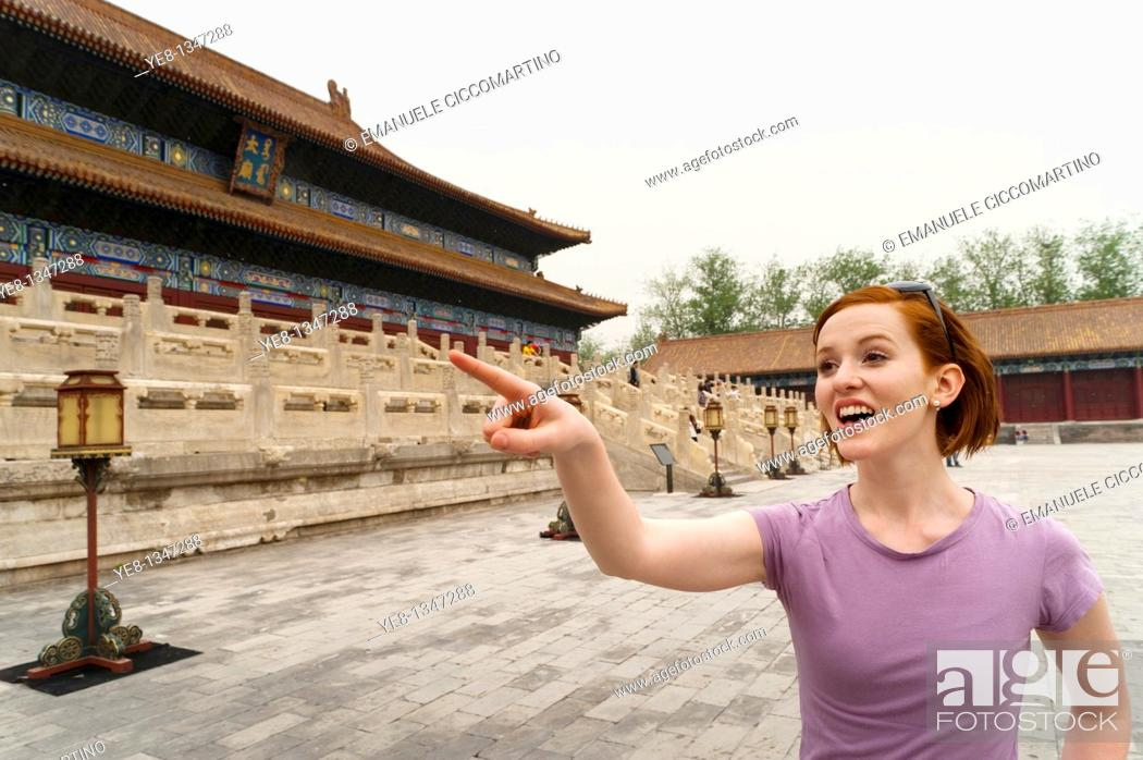 Stock Photo: Tourist pointing something out in The Forbidden City, Beijing, China, Asia  MR.