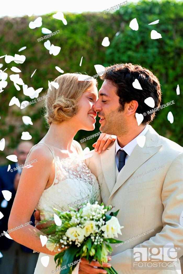 Stock Photo: Newlyweds kissing at marriage ceremony.