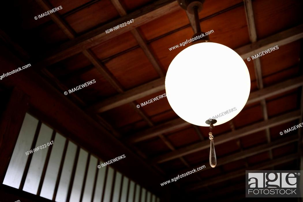 Stock Photo: Low angle view of a designed lamp.