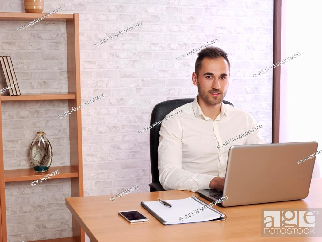 Stock Photo: Image representing a young man doing work in the office or at home.