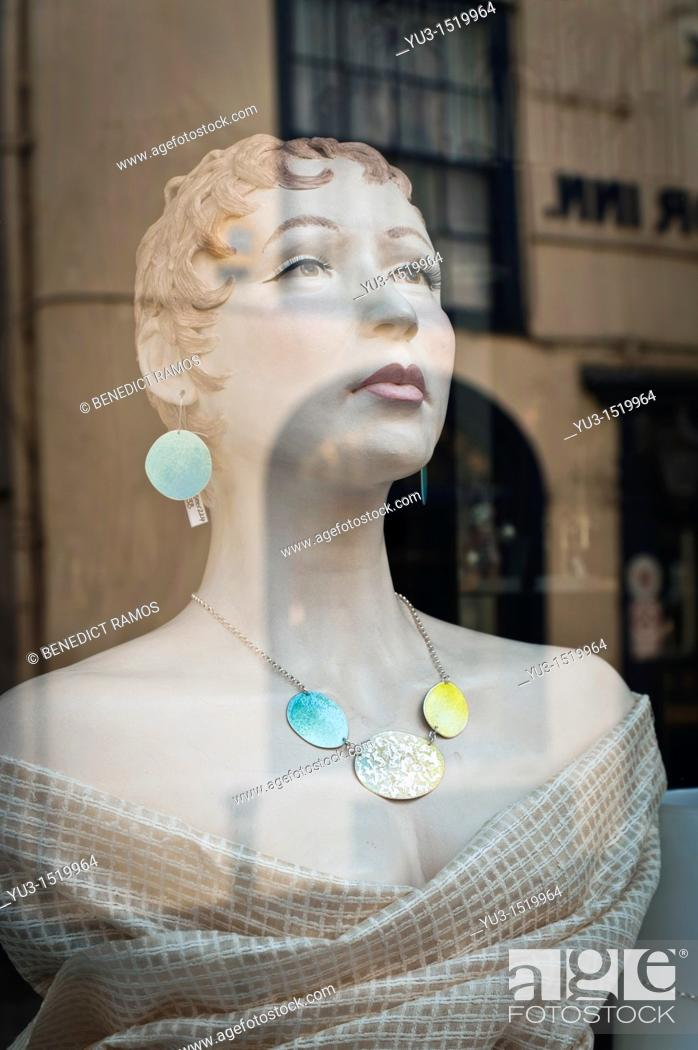 Stock Photo: Shop dummy in jewelry store window, Hastings, East Sussex, England, UK.
