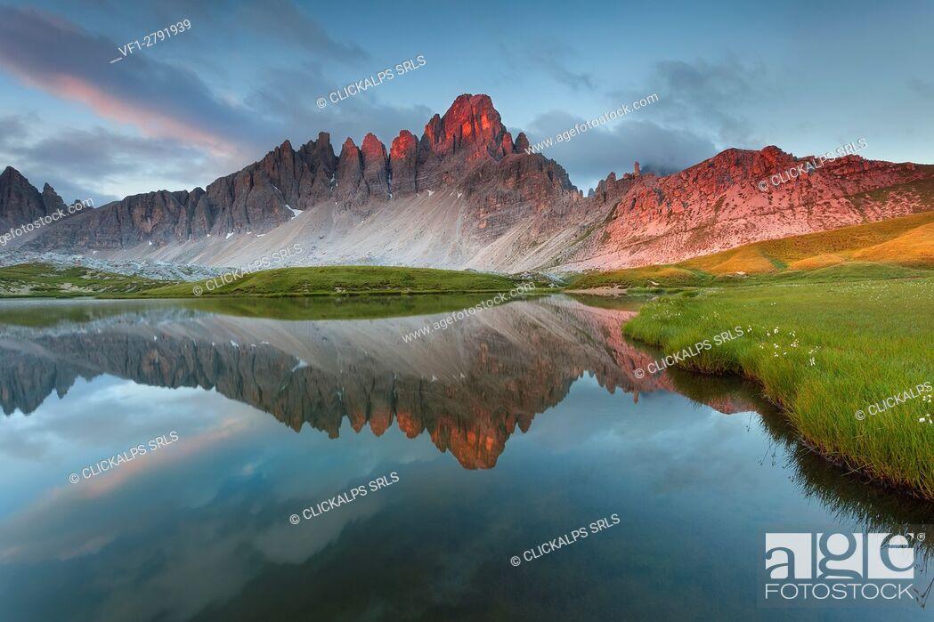 Stock Photo: Monte Paterno, Dolomites, Italy. The mountain reflects onlaghi dei Piani, alpine lakes, at sunrise.