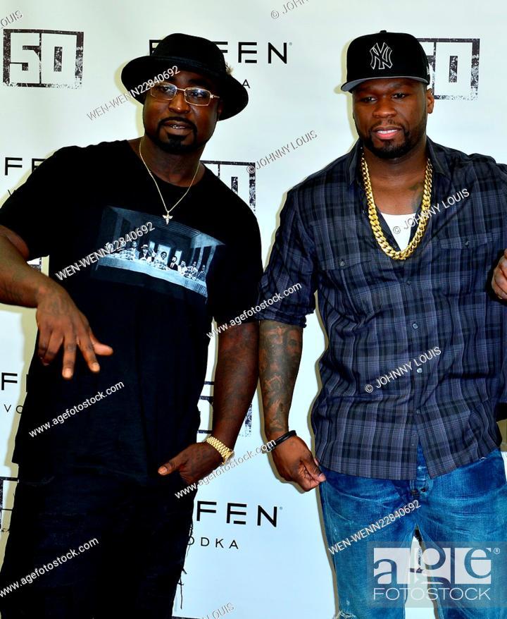 "Curtis ""50 Cent"" Jackson signs an Effen Vodka bottle at"