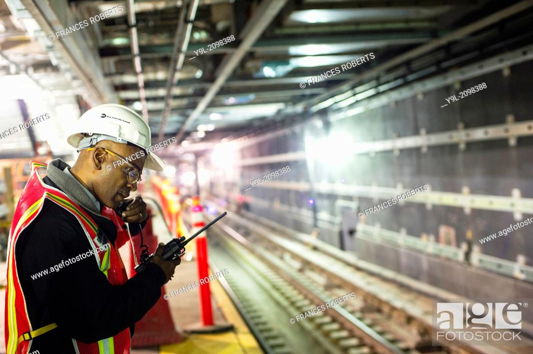 Stock Photo: An MTA worker at the new 34th Street-Hudson Yards terminal station on the 7 Subway line extension in New York. The new tunnel from Times Square.