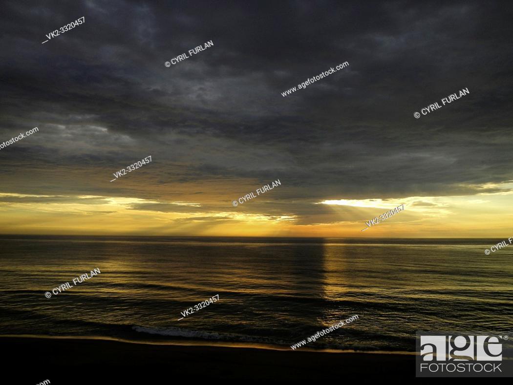 Stock Photo: Sea turned to gold at sunrise, Virginia Beach Virginia.