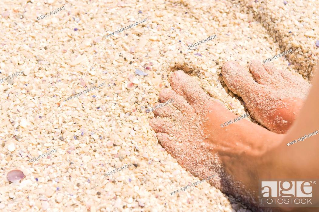 Stock Photo: Close-up of man's feet on sand.