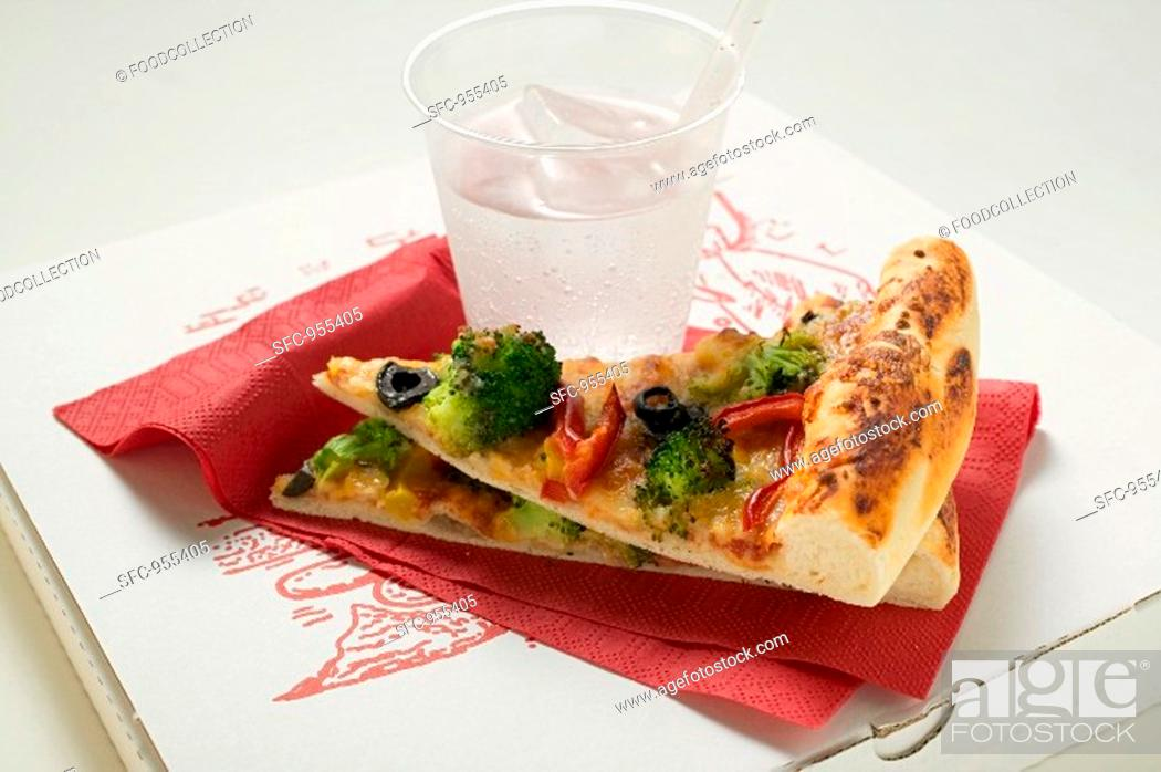 Stock Photo: Two pieces of American-style vegetable pizza & mineral water.