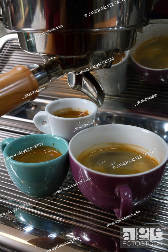 Stock Photo: Coffee cups of different size with expresso, in an Italian style machine.
