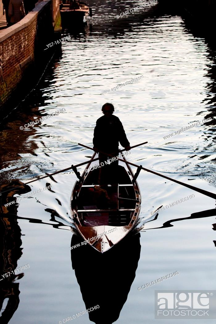 Stock Photo: Traditional rowing boat along a Venice canal, Venice, Italy, Europe.