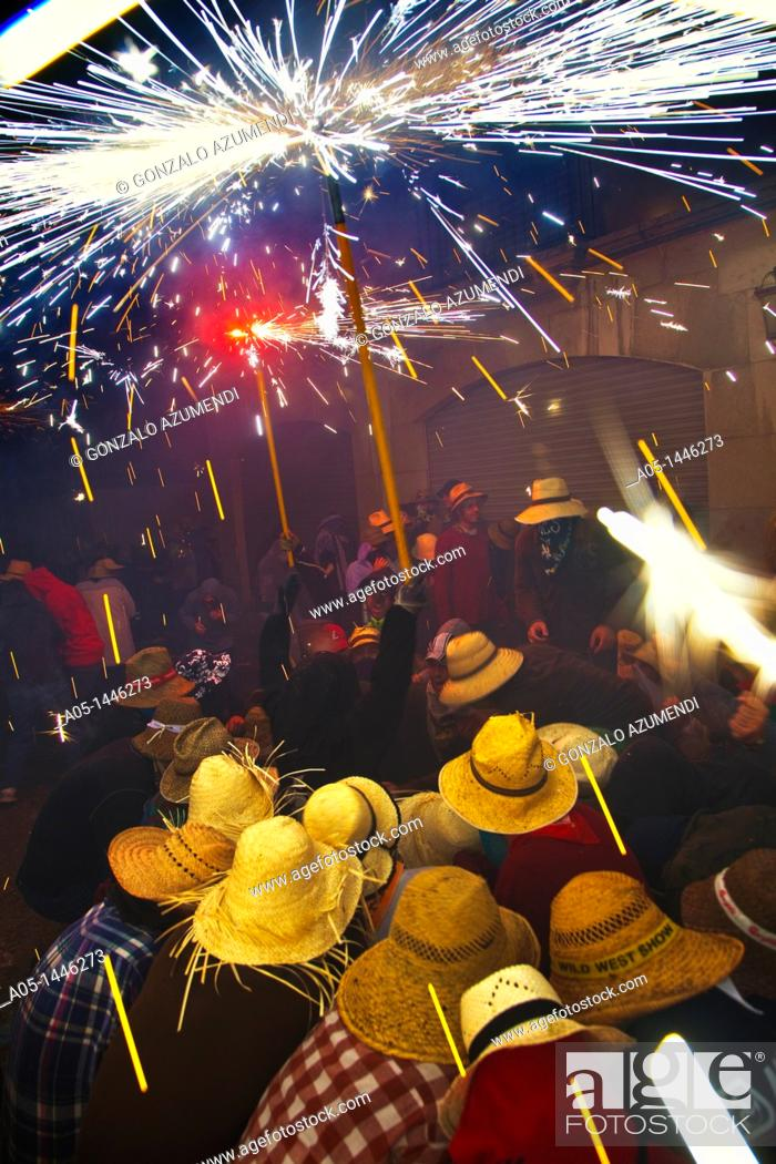 Stock Photo: 'Correfoc' Catalan traditional festival 16th August where people dressed as devils light fireworks while dancing in the street, La Bisbal d'Emporda.
