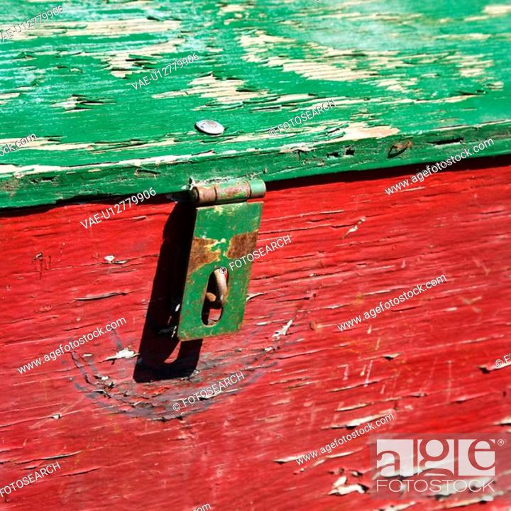 Stock Photo: Old red and green weathered wooden storage container.