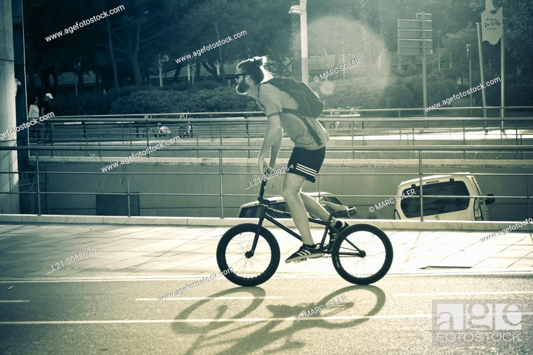 Stock Photo: Young man riding a BMX bicycle style. Barcelona, Catalonia, Spain.