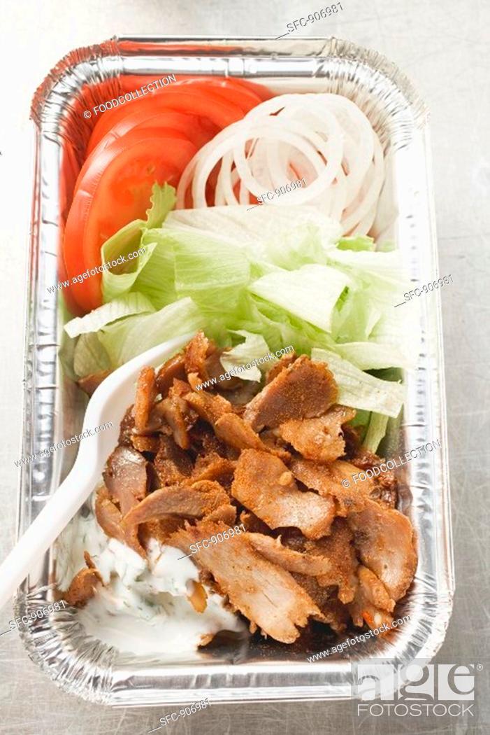 Stock Photo: Döner kebab with vegetables in aluminium dish.