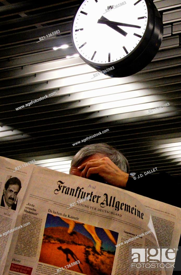 Stock Photo: Man reading one of the leading newspaper in Germany, the 'Frankfurter Allgemeine'.
