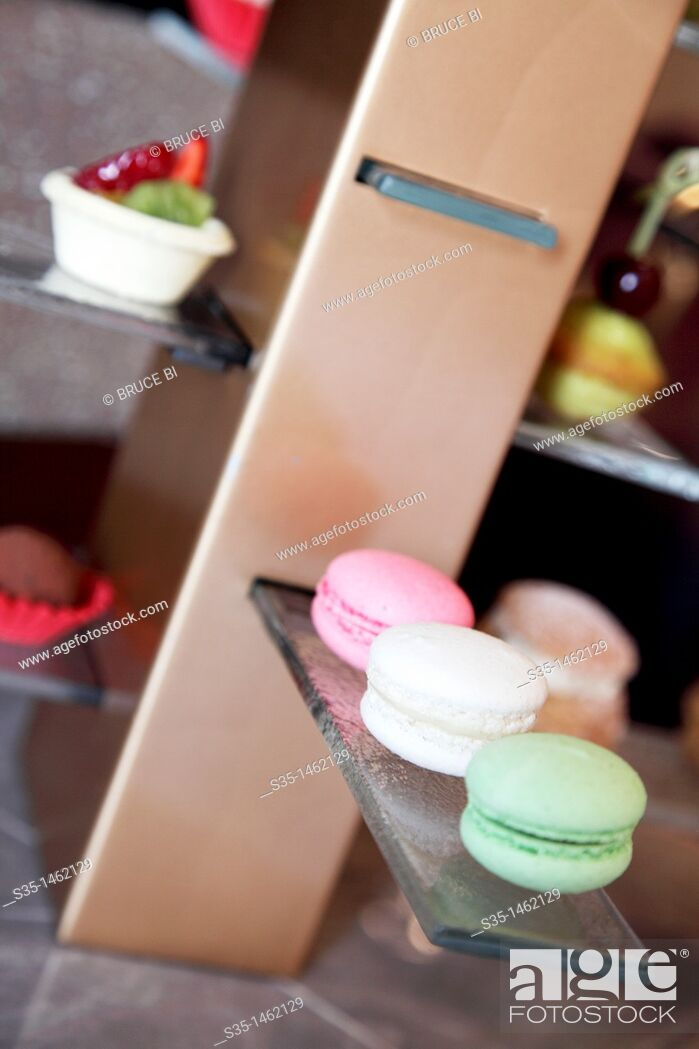 Stock Photo: Macarons and other French style desserts as welcome gift display in the hotel room of Hotel Sofitel Macau at Ponte 16, Macau, China.