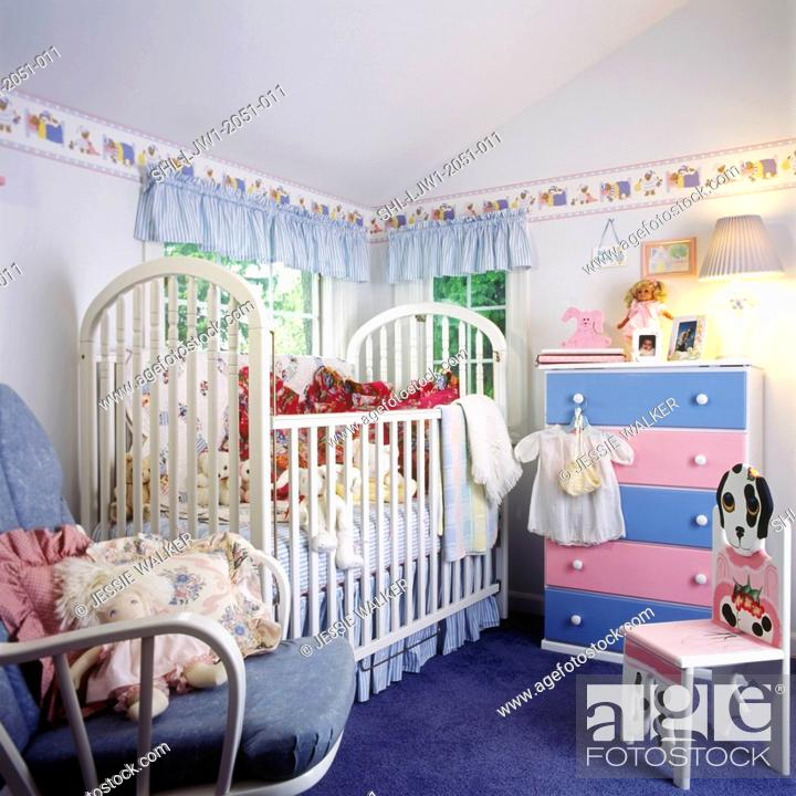 Stock Photo Children S Bedroom View Towards White Crib Chest With Pink Blue Drawers Glider Rocker Chair Cute Puppy Dog On Right Side