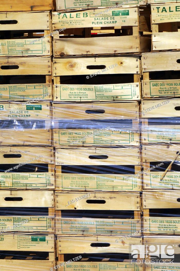 Stock Photo: Stacks of wooden fruit crates at a fruit stand.